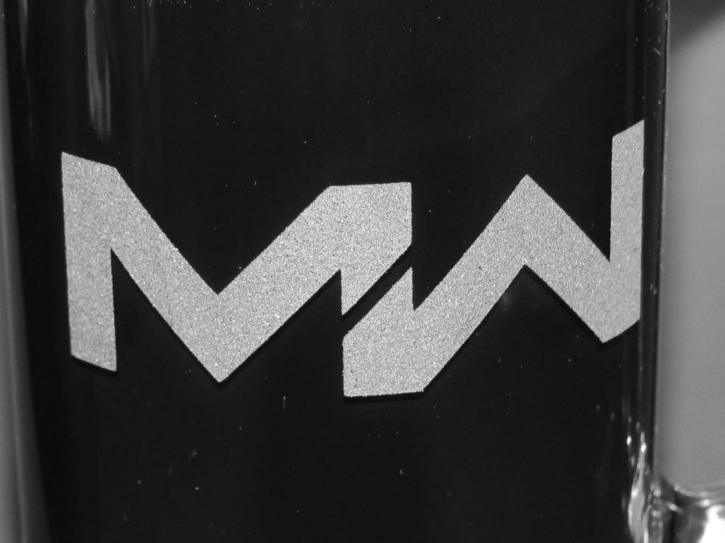 Close up image of MW image etched on Beer mug